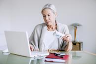 Woman Veteran looking up prescriptions on computer