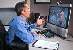 A Veteran consults with a physician from his office using VA Video Connect