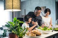Family preparing healthy food in the kitchen