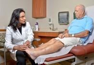 Doctor examining Veteran's feet