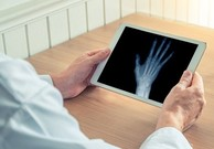 Doctor viewing an X-ray on tablet