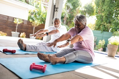 Veteran couple doing a stretching exercise