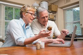 Couple looking up medication online at home