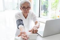Veteran checking blood pressure at home
