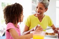 Veteran and granddaughter having breakfast together