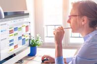 Veteran using calendar on computer to improve time management