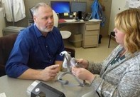 Veteran talking to a doctor about CPAP machine