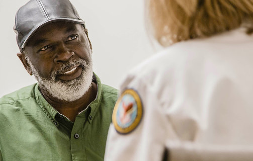 Veteran talking to a doctor about prostate cancer screenings