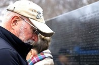 Veteran paying respects to those who have fallen