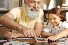 Veteran and granddaughter joining two jigsaw puzzle pieces