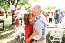 A Veteran couple on a garden party outside in the backyard