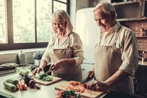 Veterans cooking fresh vegetables