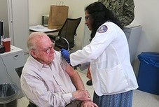 A Veteran receiving his shingles vaccination
