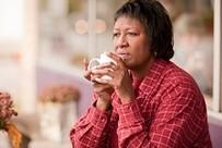 Veteran drinking coffee outside