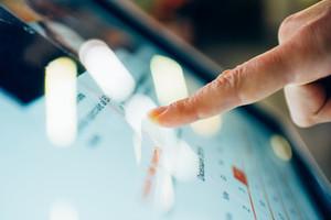 finger touching laptop screen - webinars