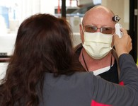 A Veteran wearing a mask during his VA appointment