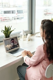 Woman on laptop on video call