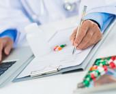 hands writing prescription