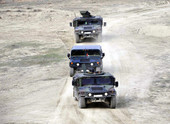 military vehicles driving in desert