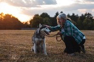 A Veteran on a peaceful walk with her dog