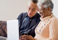 A Veteran and their spouse reviewing information about COVID-19