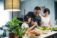 A Veteran cooking a healthy meal with the family