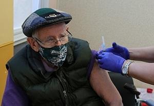 A Veteran receiving his COVID-19 vaccine