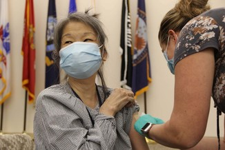 A Veteran receiving a COVID-19 vaccine