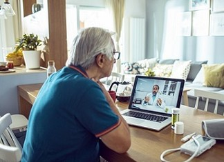 A Veteran using VA Video Connect to talk to their doctor about blood pressure