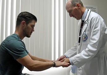 A Veteran meeting with his pain specialist