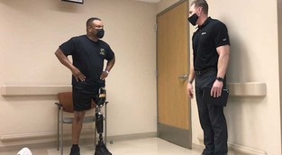 Two men with prosthetic legs standing
