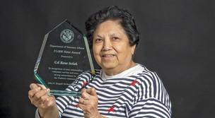 Rosa Solak holding volunteer award