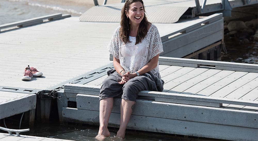 Smiling woman sitting on dock