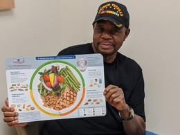 Veteran holding healthy food chart