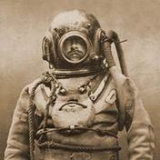 This is a typical diving suit of the period. A variation of this deep sea diving suit called the Mark V was used from 1916 all the way until 1984