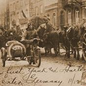 Corporal Roy Holtz, US Army: First man entering Germany as he rides a Harley-Davidson motorcycle on 11/12/18