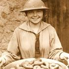 Donut Girl or Lassie in WWI Tin Helmet holding a bowl of confections