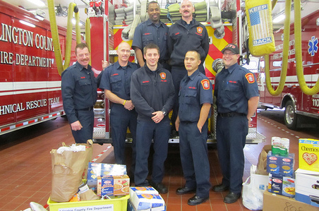arlington county firefighters with food collections