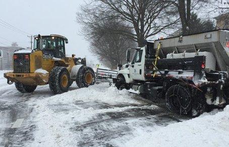 snow plow and bulldozer removing snow