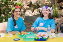teens making crafts with flower crowns