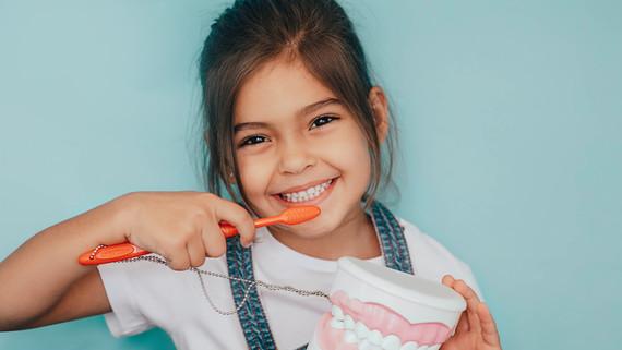 Child holding toothbrush