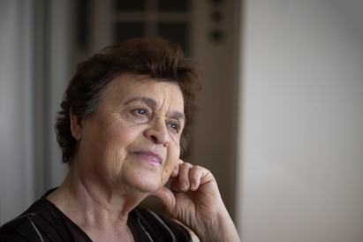 Portrait of a senior woman looking out a window.