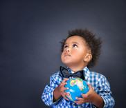 toddler holding globe