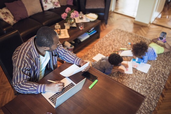 Dad working from home with kids