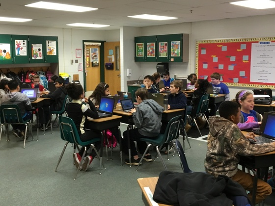 Picture of students reading silently at desks