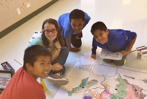 photo of students creating large map