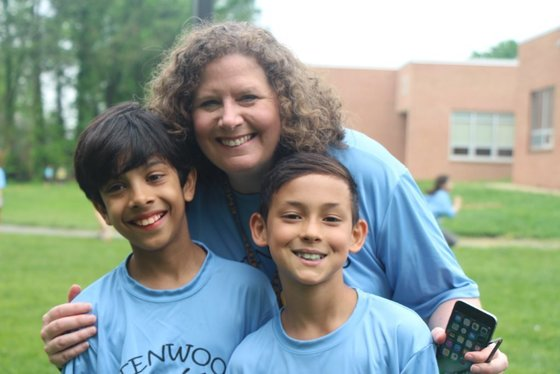 Principal, Mrs. Dammeyer with two students