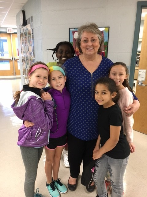 Carrie Powers with students