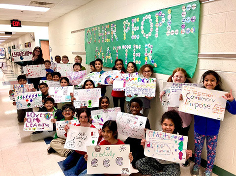 mc nair elementary students holding positivity posters