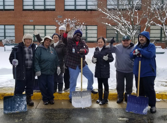 Falls Church HS custodians after shoveling snow
